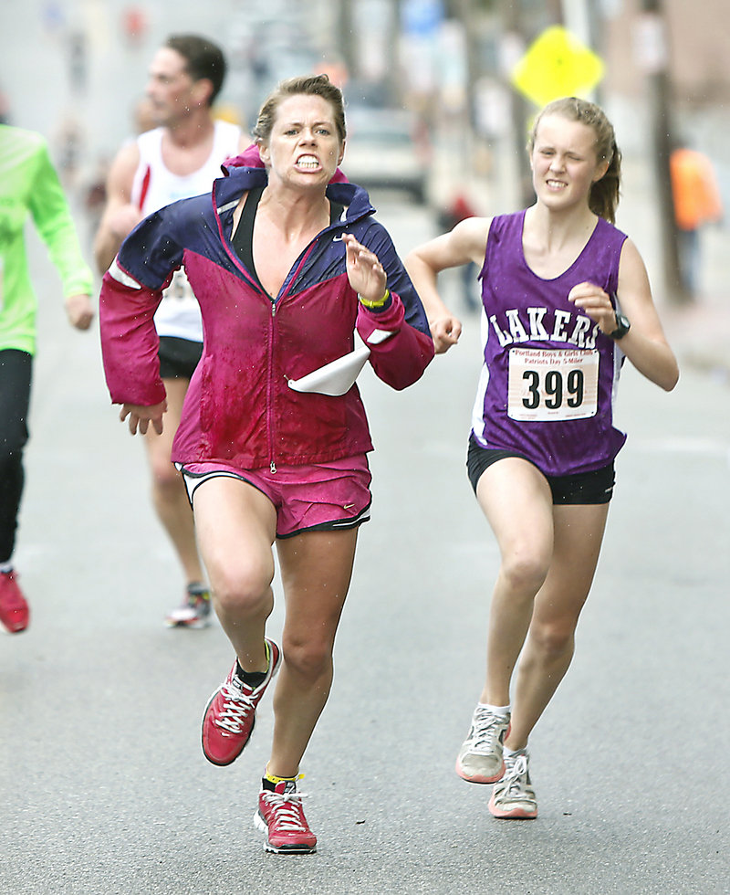 Competition is keen at the finish as Laura Johnson, left, of Portland edges Anne McKee, 14, of Hallowell for second place in the women's division.