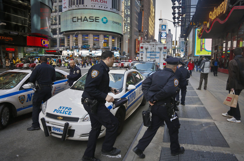 Police monitor New York's Times Square as security in the city was stepped up following the explosions at the finish line of the 2013 Boston Marathon on Monday.