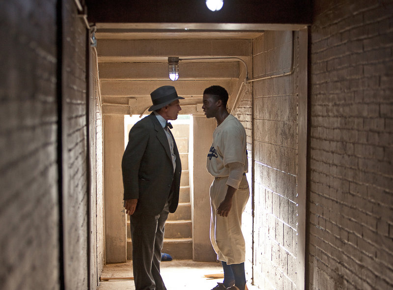 "Harrison Ford and Chadwick Boseman in ""42."""