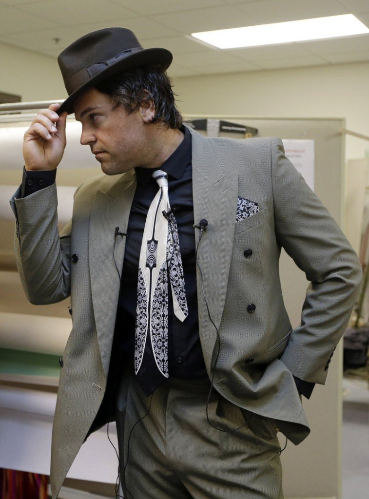 """Mike Piazza strikes a pose as he is fitted for his costume for his role in """"Slaughter on Tenth Avenue"""" in Miami Beach."""