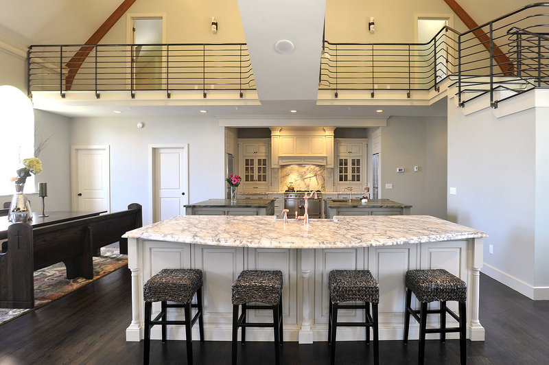 The kitchen in the former Payson Park Evangelical Free Church on Ocean Avenue, now a residence, features a large, marble-covered island.