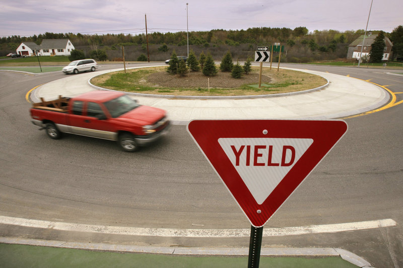 In this May 2009 file photo, cars pass through a roundabout along the Gorham bypass at the junction of Route 114. Roundabouts, which are smaller, slower and thus safer than rotaries, are the way to go, experts say.