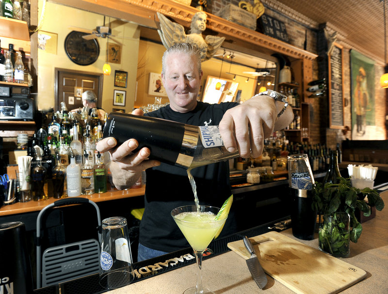 Co-owner and bartender Noah Talmatch pours a cucumber gin martini at The North Point.