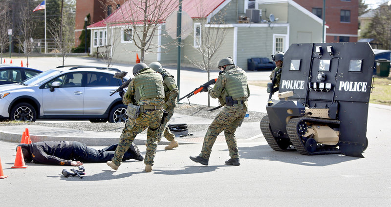 Members of the Southern Maine Special Response Team approach a