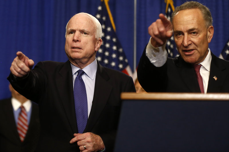 Sen. John McCain, R-Ariz., left, and Sen. Charles Schumer, D-N.Y., take questions on immigration reform legislation Thursday on Capitol Hill.