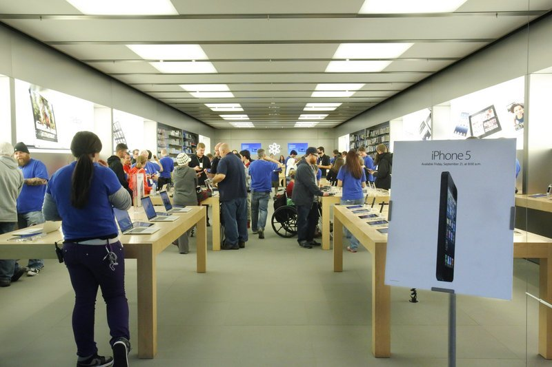 In September, the Apple Store in the Maine Mall in South Portland drew customers to purchase the iPhone 5. Now Apple's sales are slowing.