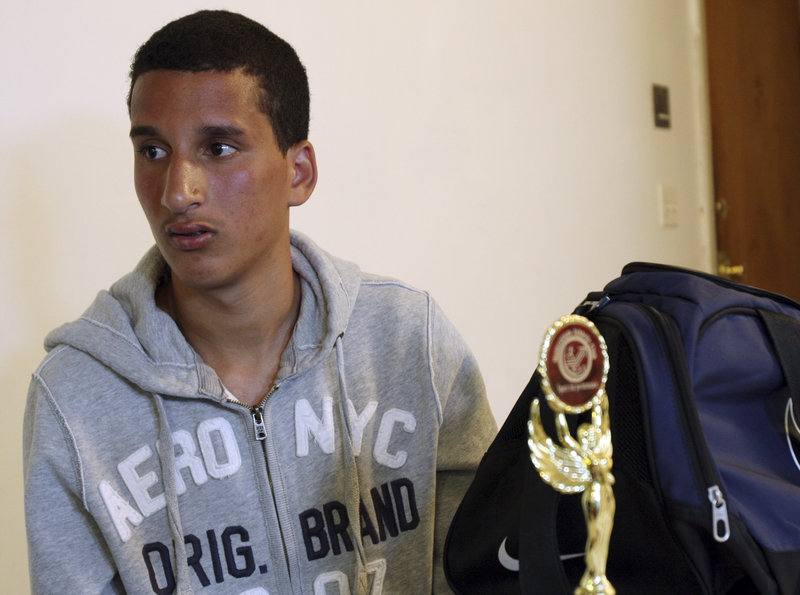 Salah Eddin Barhoum sits in his apartment in Revere, Mass. The New York Post ran his photo on the front page Thursday in connection with the Boston Marathon bombings.