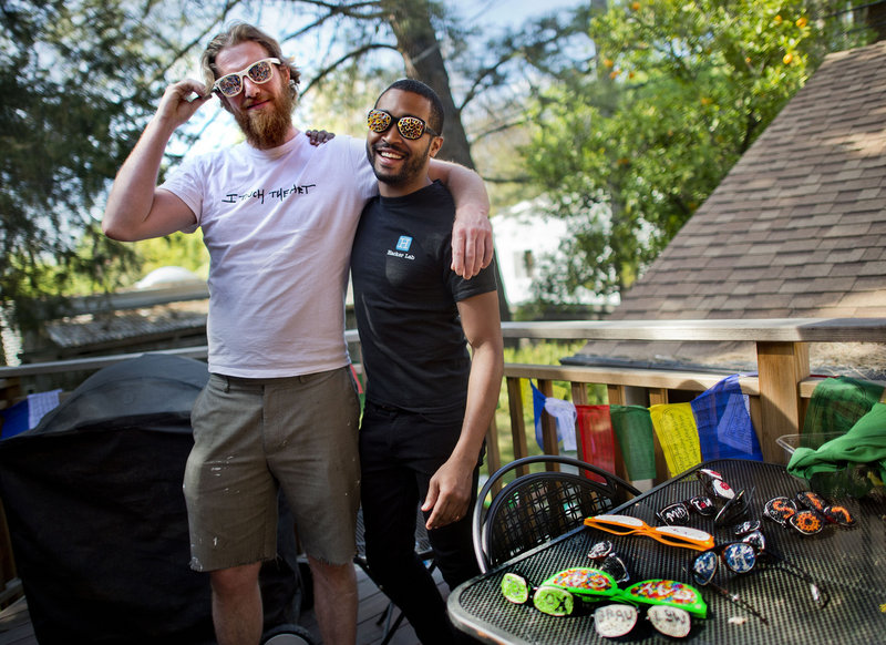 Artist Danny Scheible, left, and his business manager Tre Borden raised $16,000 via crowd funding to make Hacker Glasses. Projects like this one will be able to raise $1 million a year, thanks to a new crowd funding law.