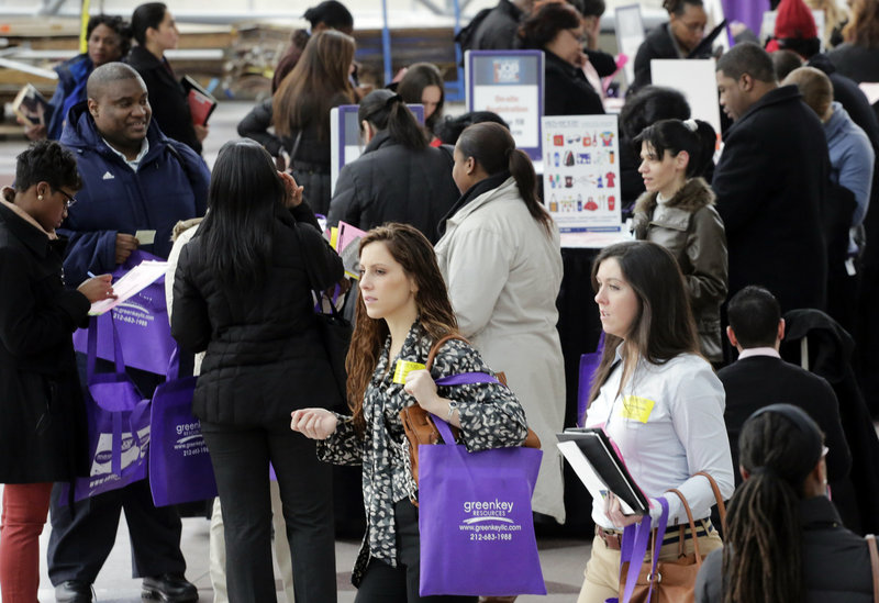 Job fairs like this one in New York on March 14 are expected to be the norm by Americans who responded to a poll from The Associated Press.