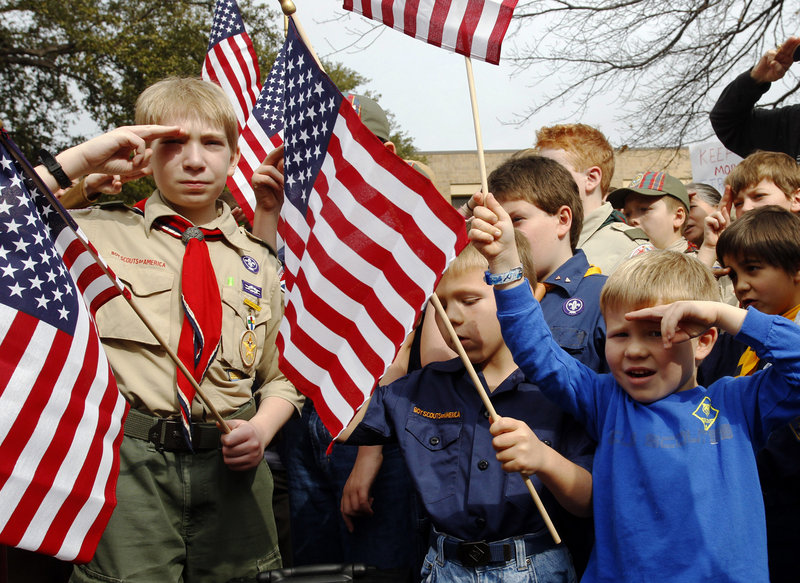 """From left, Joshua Kusterer, 12, Nach Mitschke, 6, and Wyatt Mitschke, 4, take part in a """"Save Our Scouts"""" rally at the Boy Scouts of America National Headquarters in Dallas, Texas. The organization announced Friday that it will submit a proposal to lift a ban on homosexuals for members but continue to exclude gays as adult leaders."""