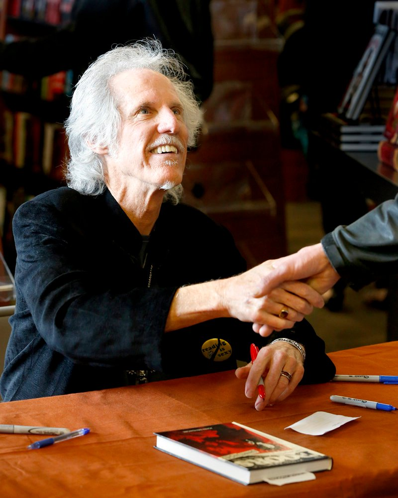 """John Densmore greets a fan while signing copies of his book, """"The Doors Unhinged,"""" at Bull Moose in Scarborough on Saturday."""