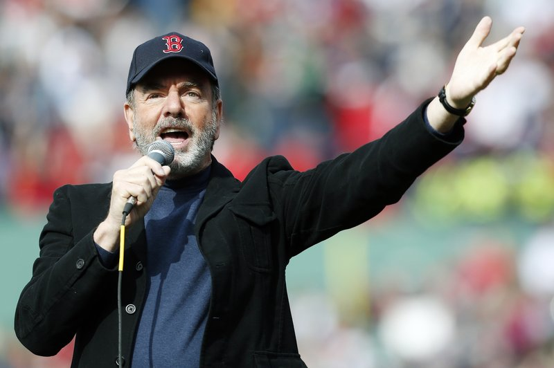 "Neil Diamond wows the crowd by singing ""Sweet Caroline"" in the eighth inning of the game. The singer asked to perform after traveling to the game on his own initiative."