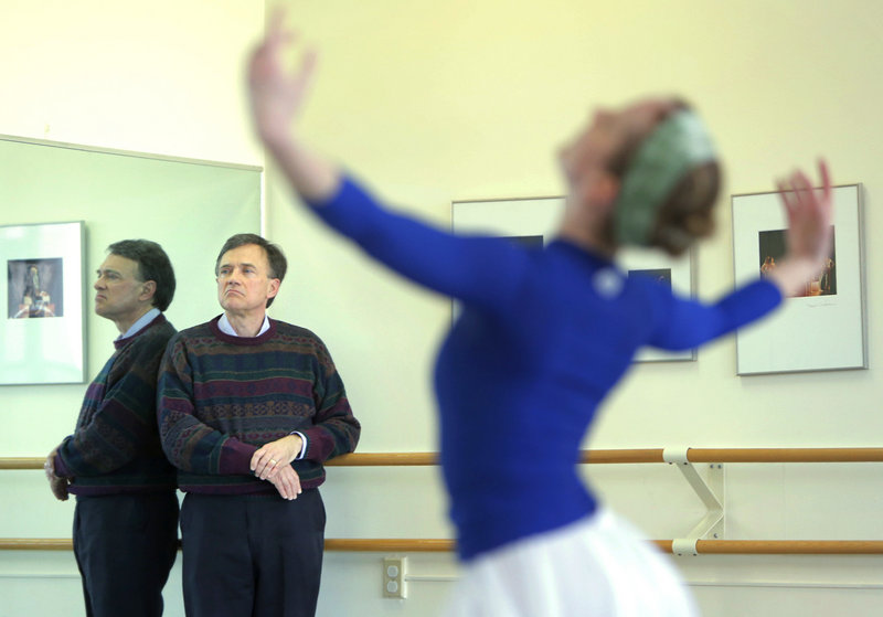 """Robert Russell, director of the Choral Art Society, watches a rehearsal of """"The Armed Man: A Mass for Peace"""" at Portland Ballet. In the foreground is dancer Jennifer Jones. The performance is Friday at Merrill Auditorium."""