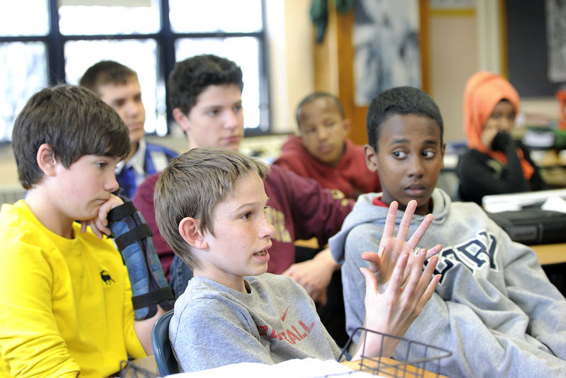 King Middle School social studies teacher Paul Clifford talks with his students about recent headlines from Boston during his class Monday, April 22, 2013. 13-year-old Kenneth Barnard, of Portland, is among students participating in the discussion.