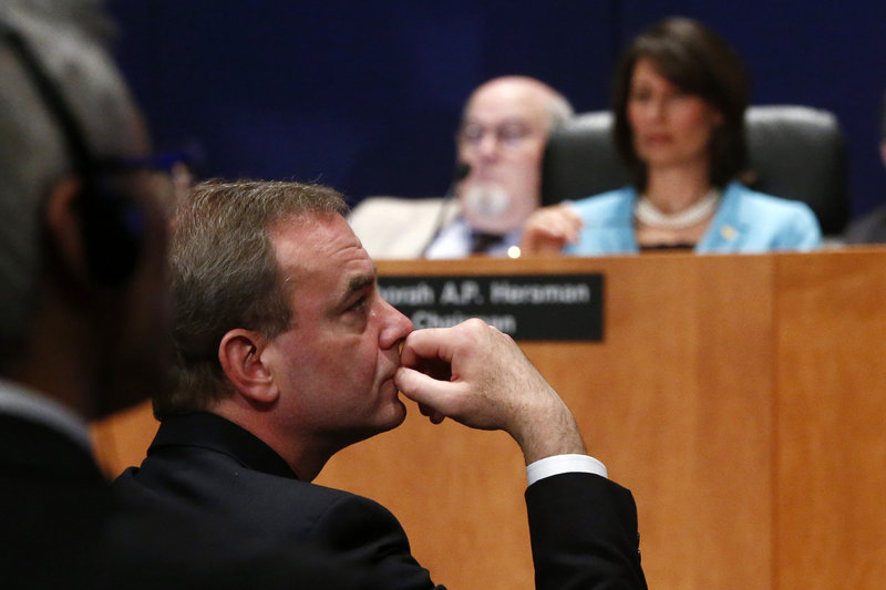 Boeing Commercial Airplanes Vice President Mike Sinnett listens during a hearing on Tuesday investigating a battery fire aboard a Boeing 787.