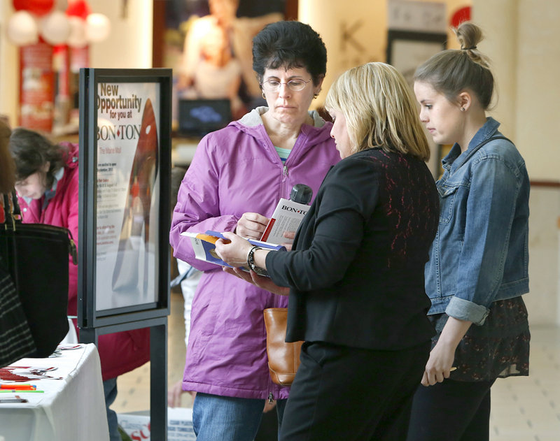 Barbara Gullbrand, left, and her daughter Bethany of Portland talk with Gail Cruikshank of Bon-Ton, which plans to open a department store at the mall in September.