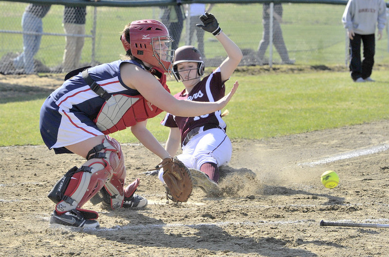 Elyse Dinan of Greely beats the ball to the plate and scores in the first inning Wednesday. The Rangers got both of their runs in the first and beat Gray-New Gloucester, 2-0. The catcher is Emily Harlow.