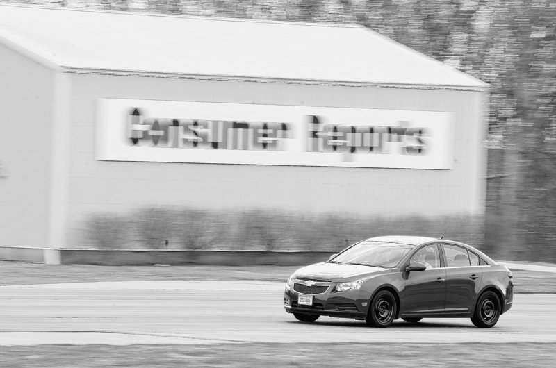 Ryan Pszczolkowski, engineer at Consumer Reports automotive testing center in East Haddam, Conn., runs a Chevy Cruz over the handling track during a tire test.