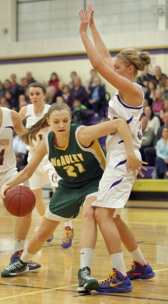 Olivia Smith of Portland's McAuley High School drives in a game against Cheverus on Jan. 15.