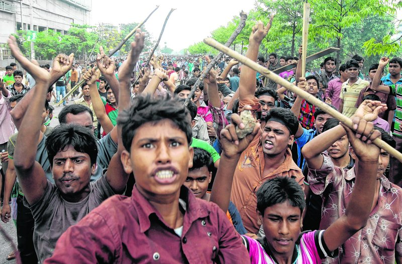 Garment workers shout slogans to protest unsafe working conditions.