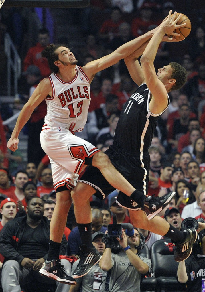 Joakim Noah of the Bulls blocks a shot by Brooklyn's Brook Lopez during Game 4 of their first-round playoff series Saturday. Chicago leads 3-1 after a 142-134 triple-OT win.