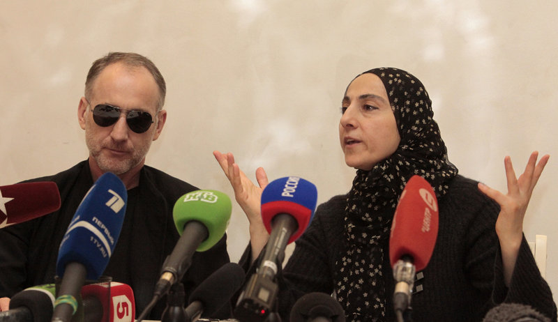 The mother of the two Boston bombing suspects, Zubeidat Tsarnaeva, speaks next to the suspects' father, Anzor Tsarnaev, left, at a news conference Thursday. There are questions about how much Zubeidat Tsarnaeva knew about her sons' plotting.