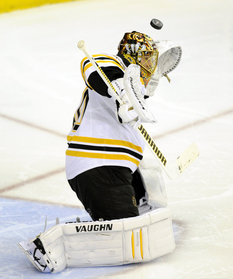 A shot sails over the glove of Bruins goalie Tuukka Rask during the third period of a 3-2 overtime loss Saturday.