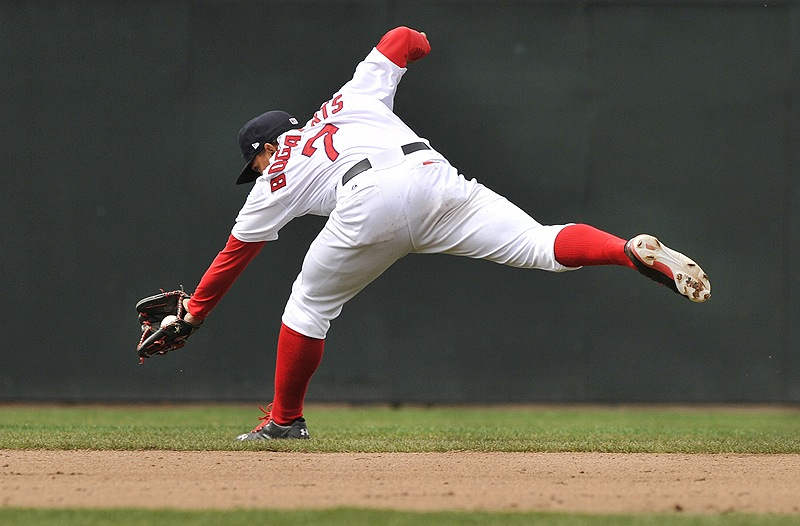 Xander Bogaerts of the Sea Dogs goes to his backhand in the shortstop hole to nab a grounder that went for an infield hit by Dan Rohlfing of New Britain at Hadlock Field.