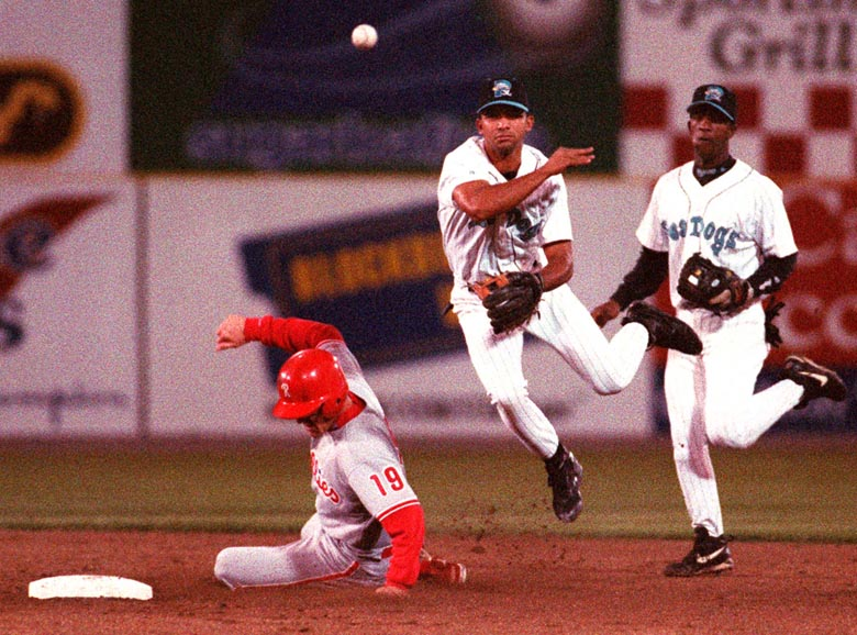 STAFF PHOTO BY DAVID MACDONALD -- Friday, August 30, 1996 -- Sea Dogs' shortstop Alex Gonzalez makes the relay to first base in an unsuccessful double play attempt in the third inning after making the force out on Reading Phillies' Scott Shores as Sea Dogs's second baseman Ralph Milliard watches. David MacDonald