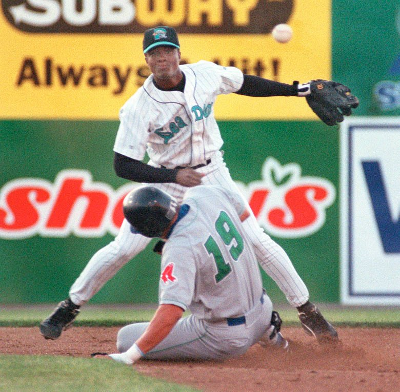 Staff Photo by David MacDonald, Mon, Jun 19, 2000: Sea Dogs' 2nd baseman Pablo Ozuna makes the relay to 1st over a sliding Virgil Chevalier of the Trenton Thunder to complete a 3rd inning double play. David MacDonald Pablo Ozuna sea dogs Virgil Chevalier baseball