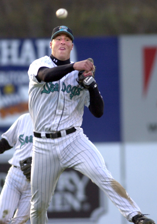 Staff Photo by Gordon Chibroski, Friday, April 27, 2001: Sea Dogs' third baseman, Heath Honeycutt fires a grounder to first base for an out in the 3rd inning in a game against the New Britain Rock Cats.. Baseball Gordon Chibroski