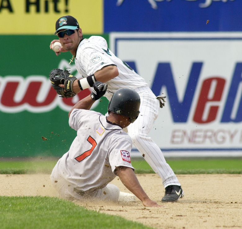 Staff Photo by Jack Milton, Thu, Jul 18, 2002: Sea Dogs #21, Jesus Medrano turns a double play in the 7th inning despite the best efforts of Erie Sea Wolves #7, Jhonny Perez. Jack Milton Jesus Medrano Sea Dogs baseball Jhonny Perez