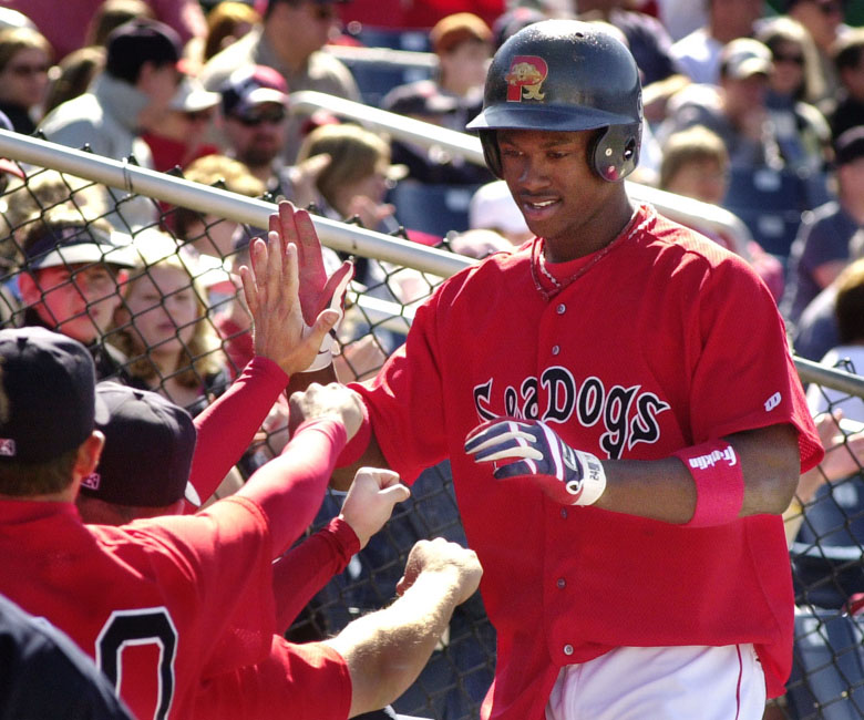 Staff Photo by Jill Brady, Sunday, April 10, 2005: Portland Sea Dog Hanley Ramirez is greeted by his teammates after scoring in the bottom of the eighth inning Sunday during baseball action against the Norwich Navigators at Hadlock Field. Baseball Jill Brady