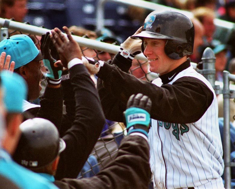 STAFF PHOTO BY DAVID MACDONALD -- Sunday, April 13, 1997 -- Mark Kotsay is congratulated by his team-mates after hitting a three run homer in the third inning, his third home run in two days. David MacDonald