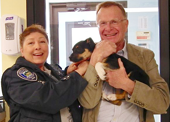 Sanford Animal Control Officer Lauren Masellas and Animal Welfare Society Executive Director Steve Jacobsen welcome Walton back to the shelter in West Kennebunk.