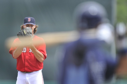 File photo/Press Herald Red Sox starting pitcher Clay Buchholz prepares to pitch to a Ray's hitter in a final home exhibition game in 2011. Baseball