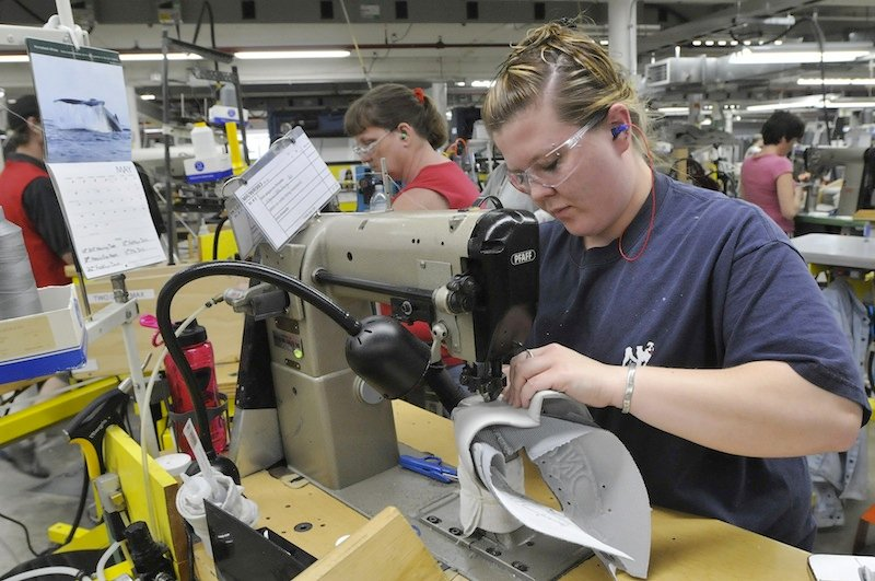 In this May 2011 file photo, Ashley Smith stitches shoes at New Balance in Norridgewock.