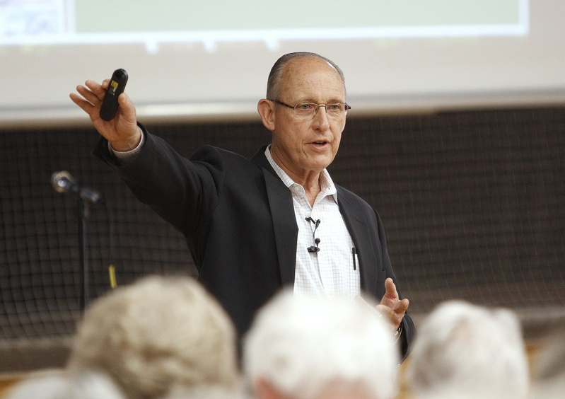 Peter Vigue, chairman and chief executive officer of Cianbro Corp., addresses a public meeting in May 2012 on the proposed east-west highway.
