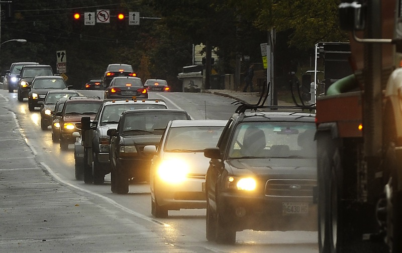 This October 2012 file photo shows heavy traffic on Broadway in South Portland. Predictions of rain every day but Monday, and cool temperatures too, could put a damper on Memorial Day travel this weekend.