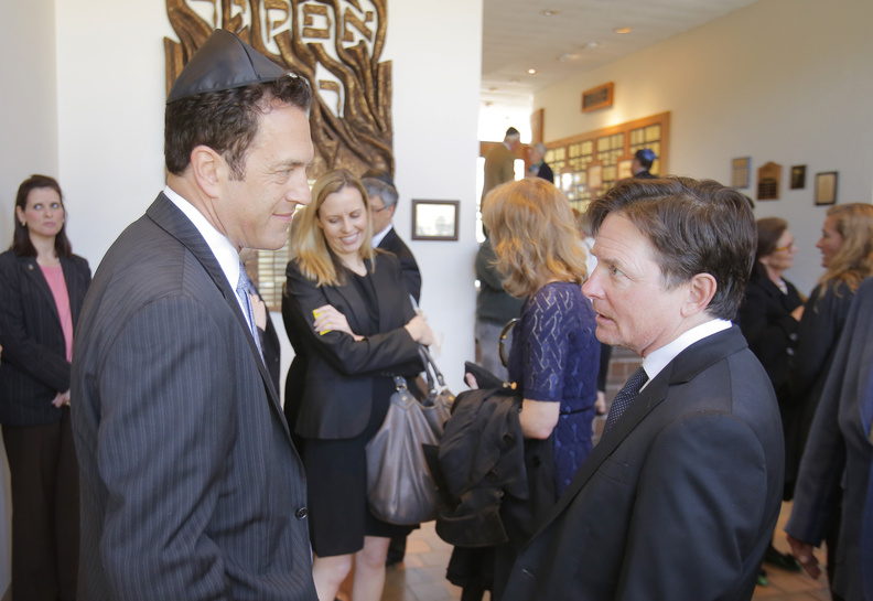David Glickman, left, son of Albert Glickman, talks with actor Michael J. Fox after the funeral for Albert Glickman at Temple Beth El in Portland on Wednesday. Albert Glickman, who passed away on April 27, was on the board of the Michael J. Fox Foundation for Parkinson's Research.