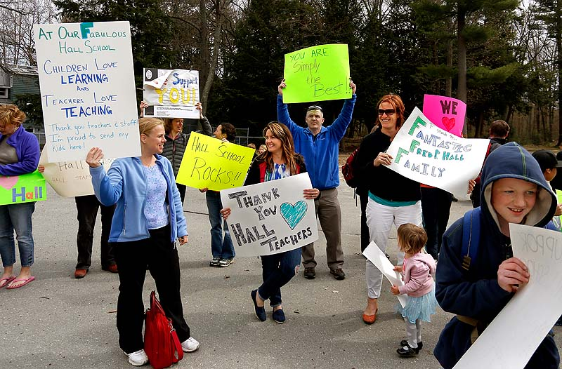 Parents gather at the Fred P. Hall Elementary School on Thursday to show their support for teachers after the LePage administration gave the school an