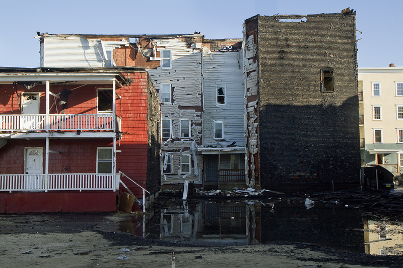 Buildings show damage in the immediate aftermath of the fire at Bartlett and Pierce streets in Lewiston on May 3.
