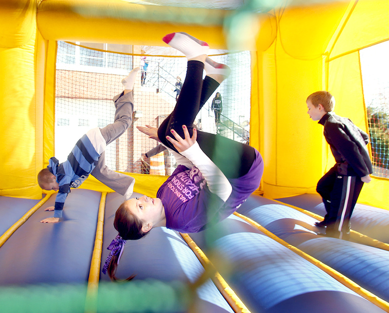 Abigail Howard,10, of Portland does a flip in a bounce house during the March of Dimes March for Babies event in Portland.