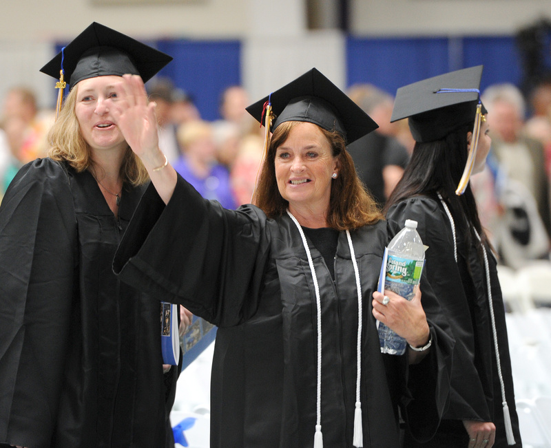 Elizabeth Murphy of Kennebunkport waves to family during the 133rd commencement at the University of Southern Maine in Gorham.