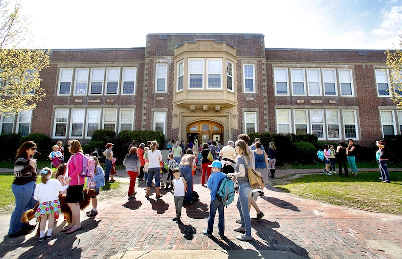 Students exit Longfellow Elementary School at the end of the school day on Friday afternoon in Portland.