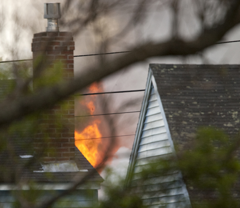 Flames at 16 Hillview Ave. in Saco are visible between neighboring houses.