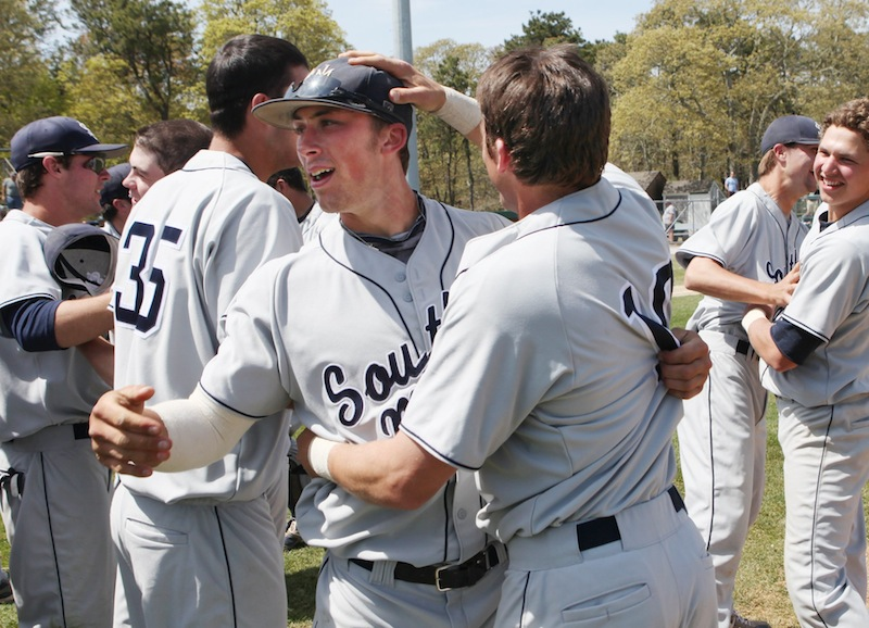 University of Southern Maine's Nick Grady, left, and Troy Thibodeau, right, celebrate their victory over Endicott College Sunday May, 19, 2013 following the championship game of the NCAA Division III New England Regional in Harwich, Mass. USM beat Endicott 9 to 0.