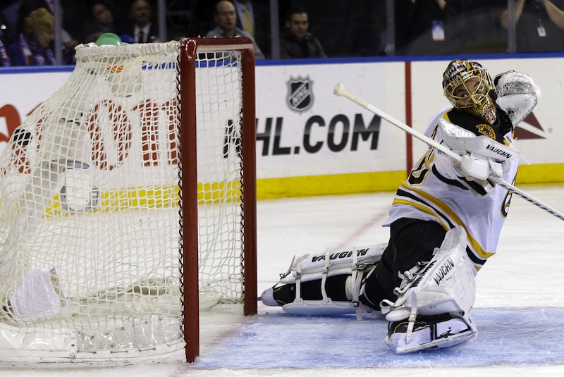 Boston Bruins goalie Tuukka Rask watches as the winning goal by New York Rangers' Chris Kreider gets past him during the overtime period in Game 4 of the Eastern Conference semifinals in the NHL hockey Stanley Cup playoffs in New York, Thursday, May 23, 2013, in New York.The Rangers defeated the Bruins 4-3. (AP Photo/Seth Wenig)
