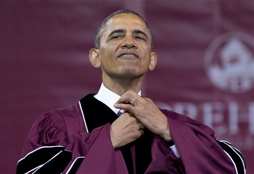 President Obama straightens his tie before he receives an honorary doctorate of laws degree during the Morehouse College commencement ceremony Sunday in Atlanta.