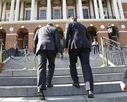 Mass. Gov. Deval Patrick, left, accompanies British Prime Minister David Cameron up the steps into the Massachusetts Statehouse in Boston on Monday.